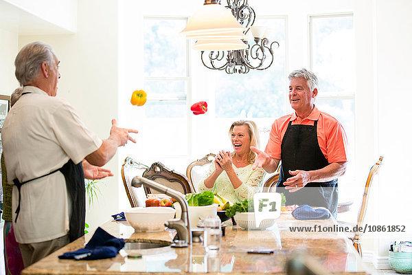Group of seniors having fun in kitchen
