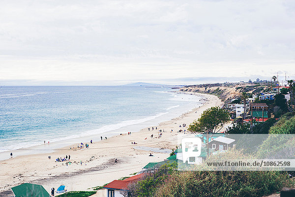 Elevated view of beach huts and distant tourists on beach  Crystal Cove State Park  Laguna Beach  California  USA