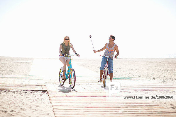 Cycling man taking a selfie at Venice Beach  Los Angeles  California  USA