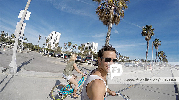 Man taking selfie cycling at Venice Beach  California  USA