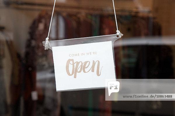 Open signage on door in vintage shop