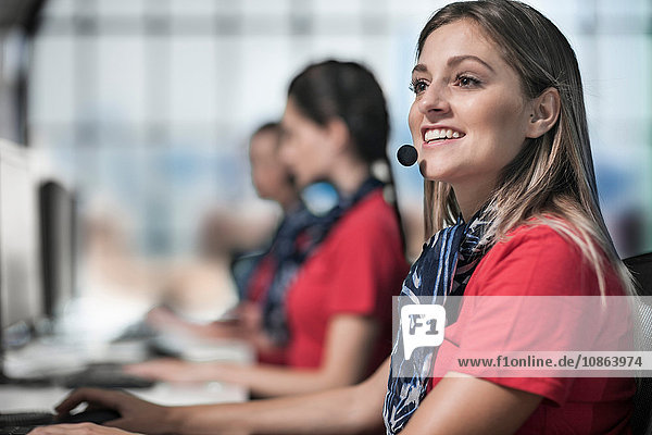 Female telephonists in a row working in call centre