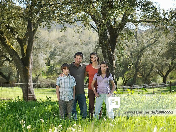 Family portrait in field with trees