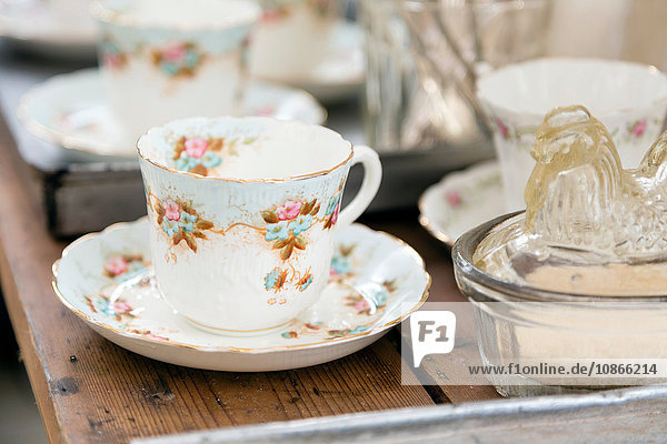 Vintage teacup and saucer on wooden table