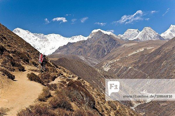 Man hiking on mountainside trail