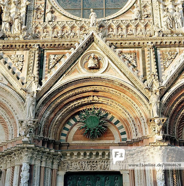 Detail of the Duomo Cathedral entrance  Siena  Tuscany  Italy.