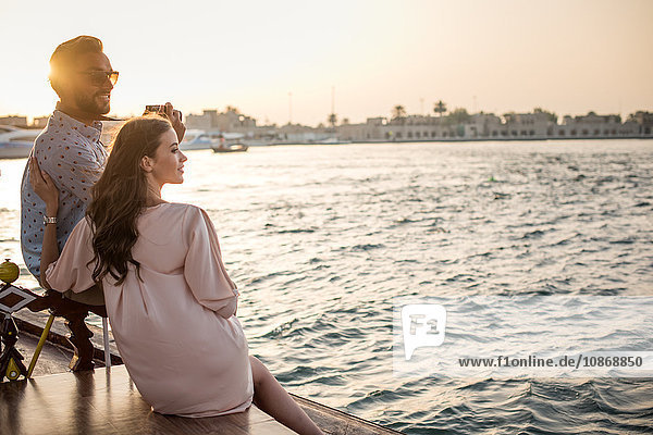 Romantic couple looking out from boat at Dubai marina  United Arab Emirates