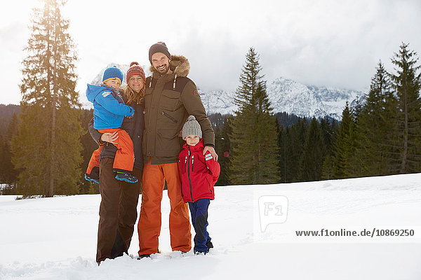 Portrait of parents and sons in snow covered landscape  Elmau  Bavaria  Germany