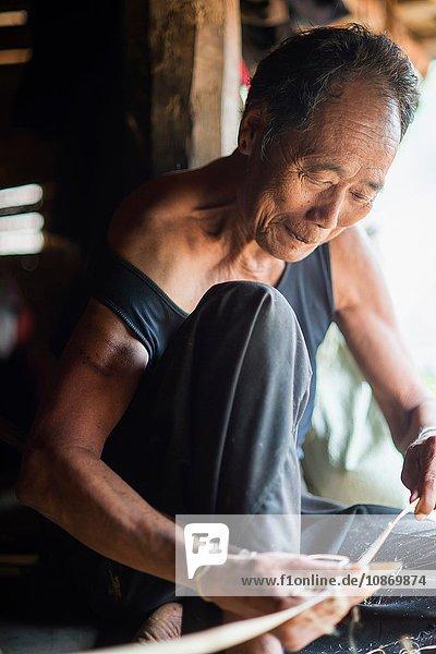 Senior man working  Shan State  Keng Tung  Burma