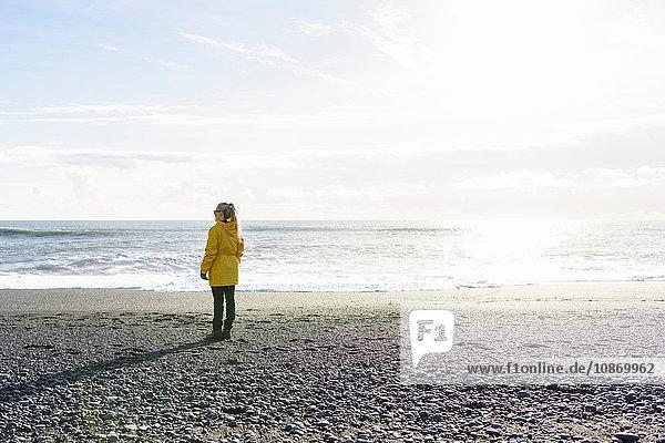 Woman enjoying beach  Reynisfjara  Iceland