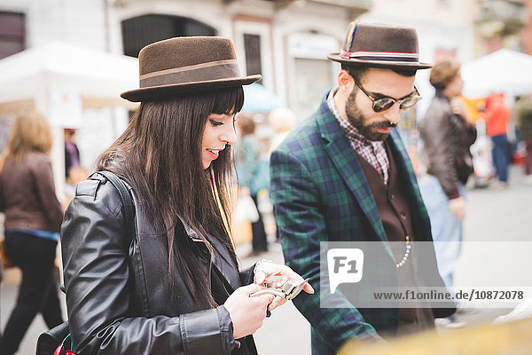 Young couple browsing at market