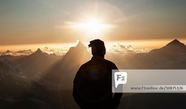 Climber watching the Matterhorn at sunset  Zermatt  Canton Wallis  Switzerland