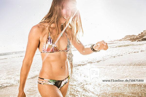 Mid adult woman wearing bikini in sunlit sea  Cape Town  South Africa