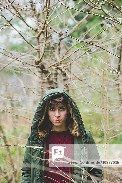 Portrait of young woman out doors wearing hooded coat