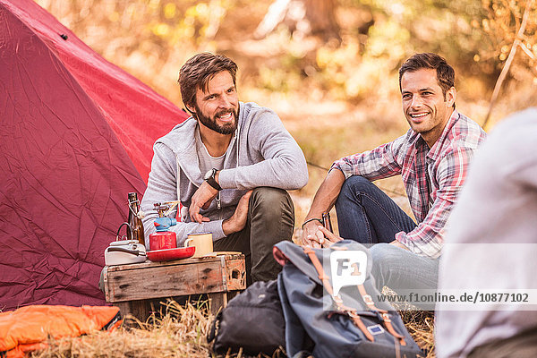 Men camping together in forest  Deer Park  Cape Town  South Africa
