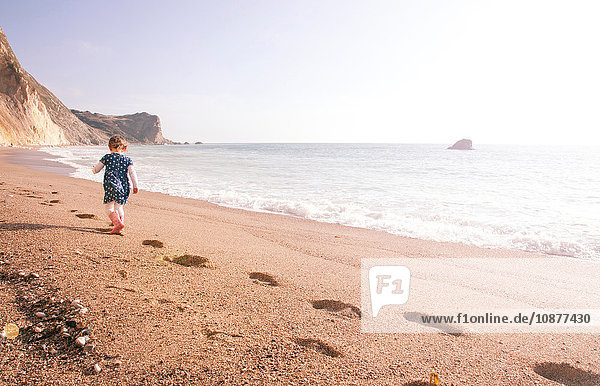 Girl enjoying beach  Man O'War Beach  Dorset