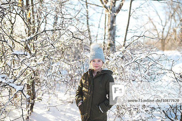 Portrait of young girl in snowy landscape
