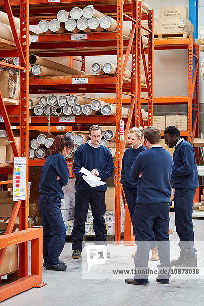 Manager training factory work team in factory warehouse