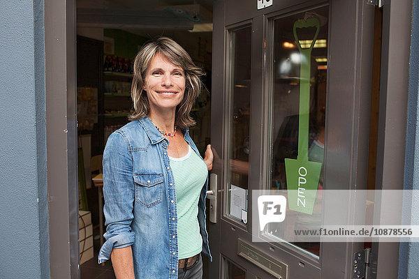 Woman standing in doorway of shop