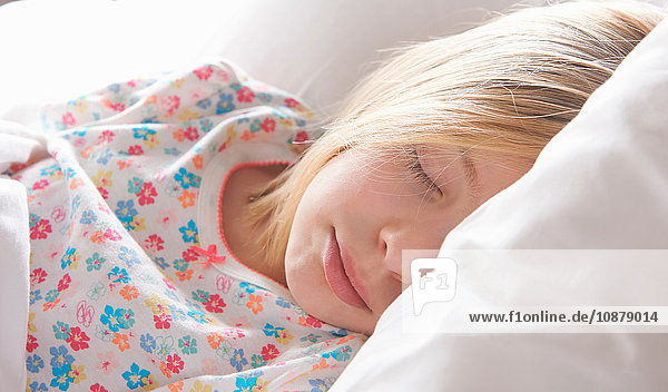 Close up of blond haired girl asleep on pillow