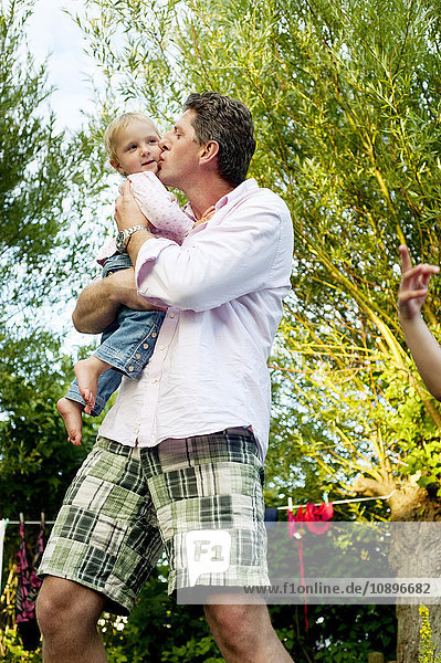 Sweden  Skane  Father holding and kissing daughter (2-3)