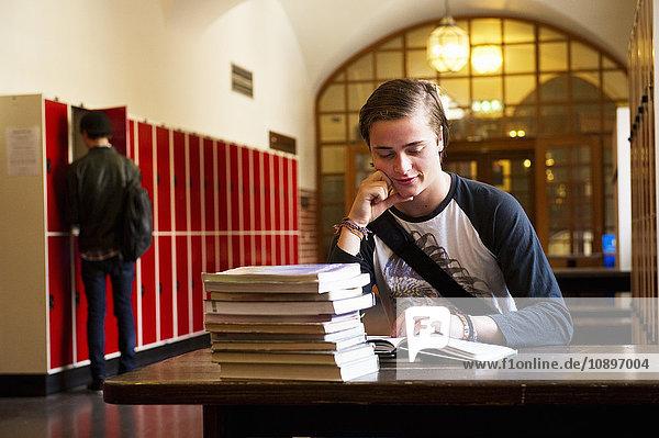 Sweden  Stockholm  Ostermalm  Male student reading at desk