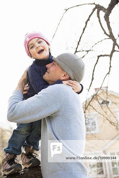 Sweden  Sodermanland  Huddinge  Stuvsta  Father and son (4-5) hugging