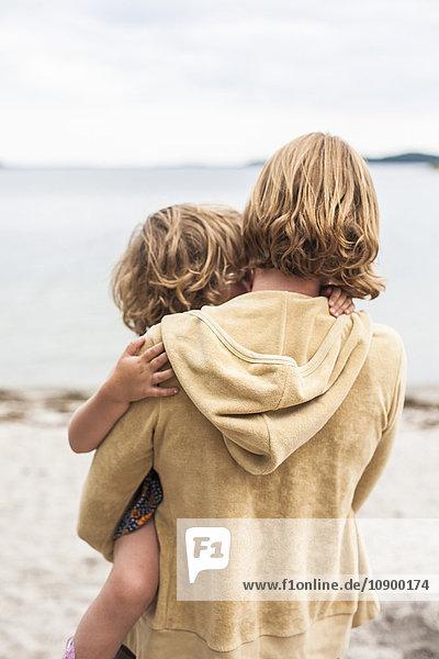 Sweden  Sodermanland  Stockholm Archipelago  Musko  Mother holding daughter (4-5)
