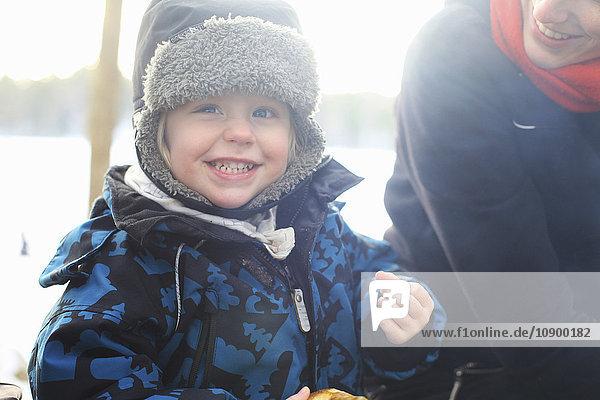 Sweden  Uppland  Lanna  Smiling little girl (2-3) wearing fur hat
