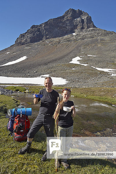 Sweden  Sarek National park  Pastavagge  Father and daughter (12-13 years) hiking in mountains