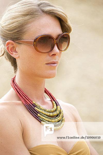 Portrait of a blonde woman wearing sunglasses
