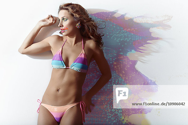 Surprised woman  splashed  colours  bikini