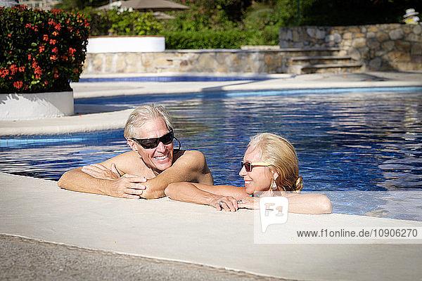 Happy senior couple in swimming pool