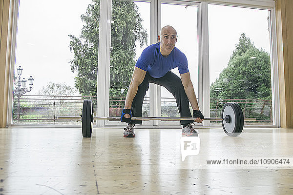 Man trying to lift a barbell