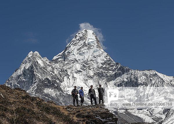 Nepal  Himalaya  Solo Khumbu  Ama Dablam  four Gurkhas in mountainscape