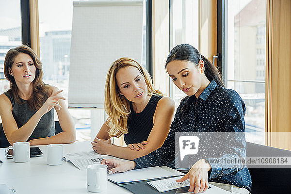 Three businesswomen having a meeting in conference room