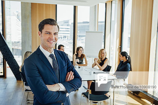 Portrait of confident businessman in a meeting
