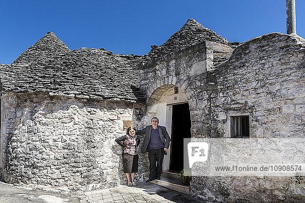 taly  Apulia  Alberobello  couple in front of Trullo