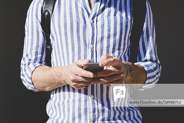 Man's hands holding smartphone
