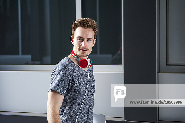 Portrait of young man with headphones and digital tablet
