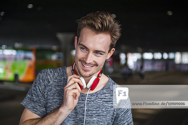 Portrait of smiling young man with headphones