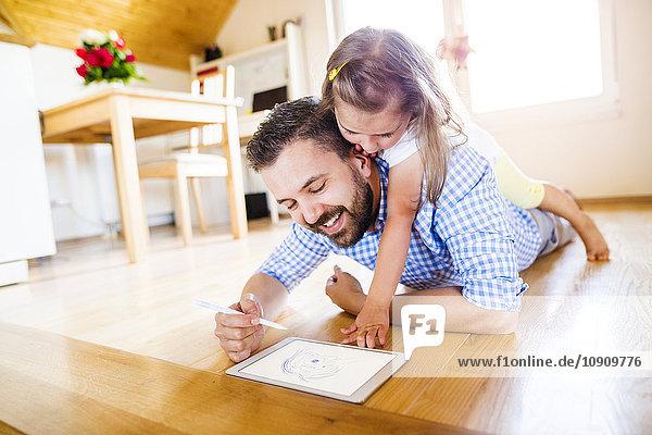 Vater und Tochter auf dem Boden liegend  Zeichnung auf digitalem Tablett