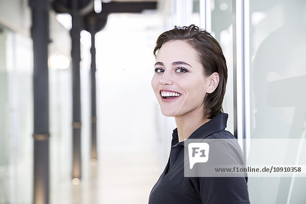 Young female dentist  laughing