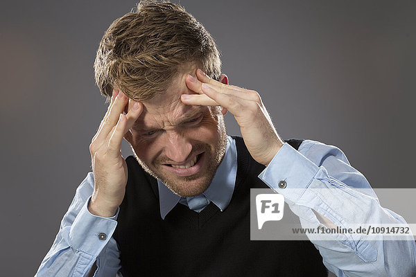 Portrait of man suffering from headaches
