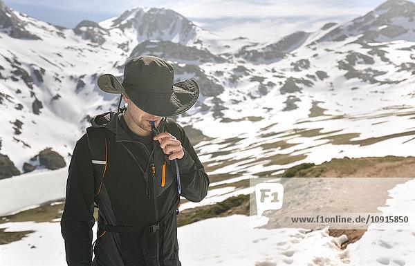 Spain  Asturias  Somiedo  man hiking in mountains