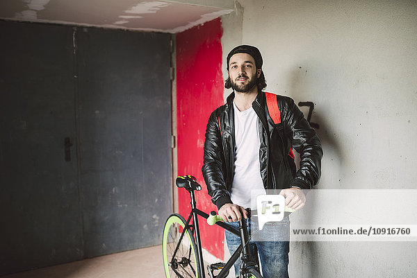 Portrait of young man with fixie bike