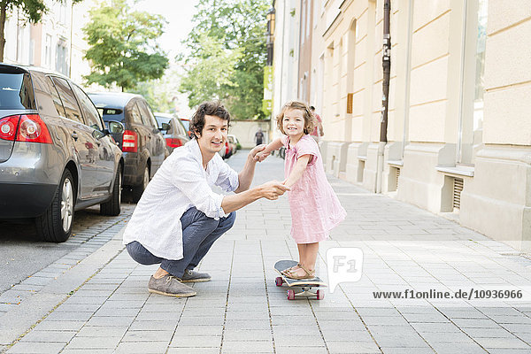 Father and daughter on skateboard