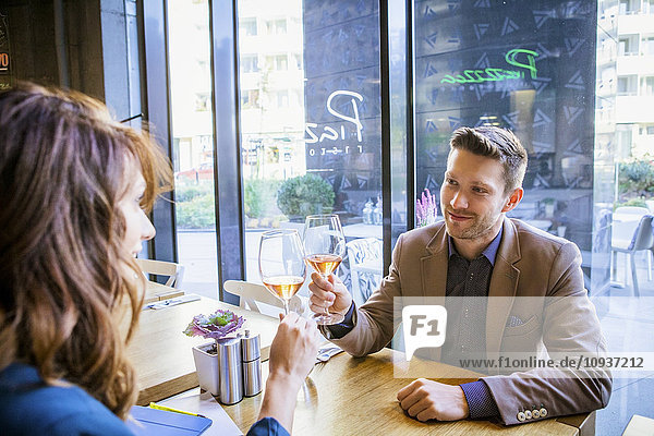 Couple toasting with wine in a restaurant