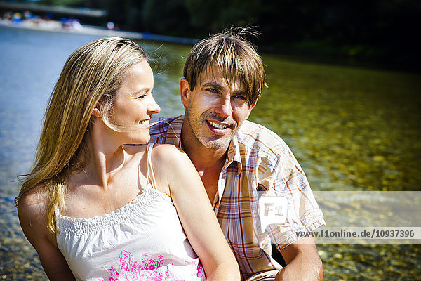 Happy young couple in a canoe  portrait  Bavaria  Germany