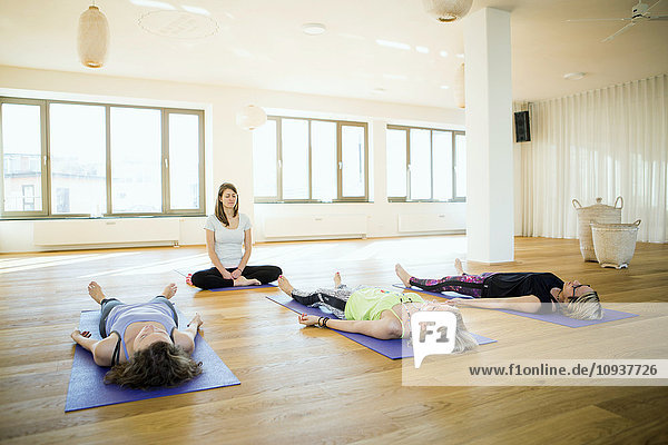 Women practicing yoga in class